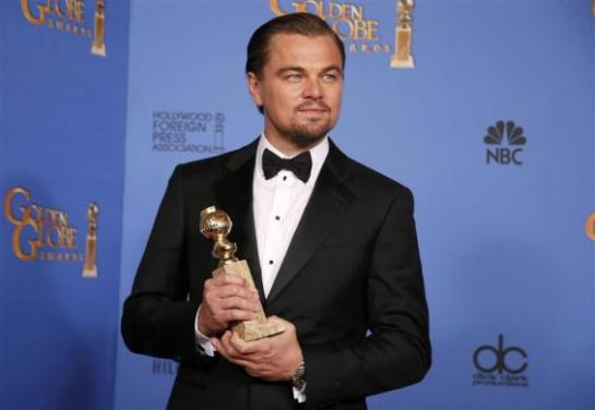 "Actor Leonardo DiCaprio poses with the award for Best Actor in a Motion Picture, Musical or Comedy for his role in ""The Wolf of Wall Street"" at the 71st annual Golden Globe Awards in Beverly Hills"