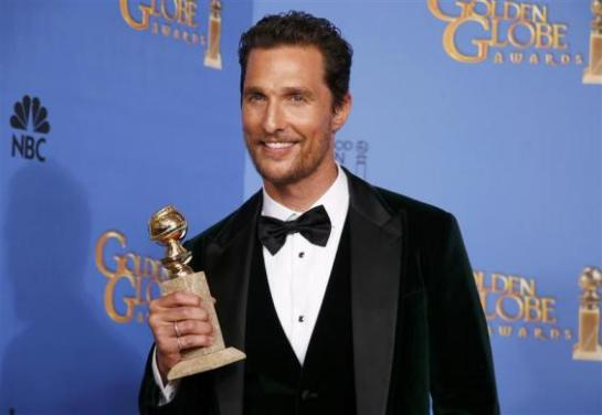 "Actor Matthew McConaughey poses backstage with his award for Best Actor in a Motion Picture, Drama for his role in ""Dallas Buyers Club"" at the 71st annual Golden Globe Awards in Beverly Hills"