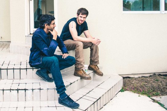 99HOMES_00096_CROP (l to r) Director Ramin Bahrani and actor Andrew Garfield discussing a scene on the set of their film, 99 HOMES, a Broad Green Pictures release. Credit: Hooman Bahrani / Broad Green Pictures