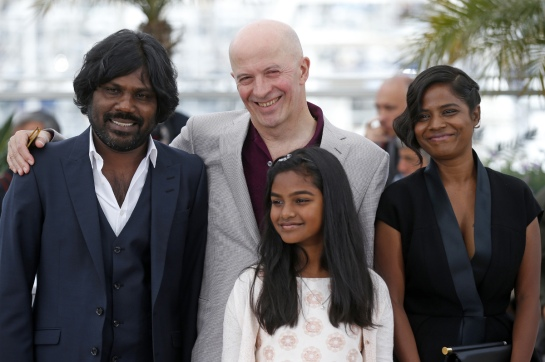 """(L-R) Cast member Jesuthasan Antonythasan, Director Jacques Audiard, cast members Claudine Vinasithamby and Kalieaswari Srinivasan pose during a photocall for the film """"Dheepan"""" in competition at the 68th Cannes Film Festival in Cannes, southern France, May 21, 2015. REUTERS/Benoit Tessier - RTX1DWSP"""